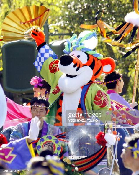 Disney character Tigger from Winnie the Pooh waves a fan with dancers to greet guests from a chauffer driven limousine during the theme park's annual...