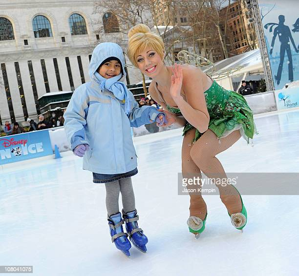 Disney character Tinker Bell poses with a child from The Sunshine Kids during a special skating experience with Princess Wishes and children from The...