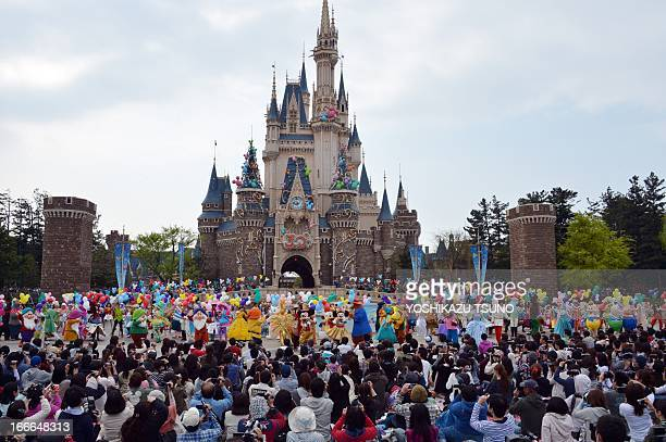 Disney characters and dancers celebrate the 30th anniversary of the Tokyo Disneyland during a ceremony at the Disney theme park in Urayasu suburban...