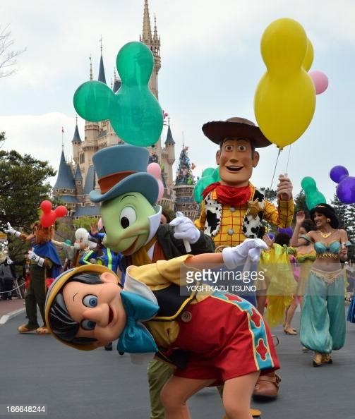 Disney characters and dancers parade as the Tokyo Disneyland celebrates its 30th anniversary in Urayasu suburban Tokyo on April 15 2013 Tokyo Disney...