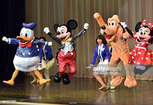Disney characters Donald Duck Mickey Mouse Pluto and Minnie Mouse perform in front of 20yearold women wearing kimonos during the 'ComingofAge Day'...
