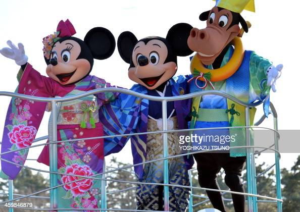 Disney characters Mickey and Minnie Mouse dressed in traditional Japanese kimonos accompanied by Disney's horse character Horace Horsecollar for the...