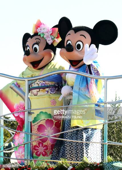 Disney characters Mickey and Minnie Mouse dressed in traditional Japanese kimonos wave to greet guests from a float during the theme park's annual...