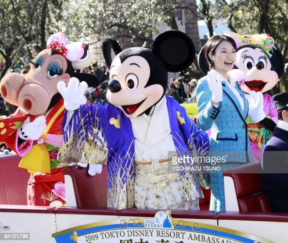 Disney characters Mickey Minnie Mouse and Clarabelle Cow dressed in Japanese traditional kimonos accompanied by Tokyo Disney Resort ambassador Makiko...