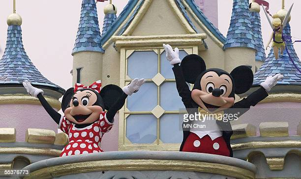 Disney characters Mickey Mouse and Minnie Mouse perform during the parade at Hong Kong Disneyland on September 11 2005 in Hong Kong The new theme...