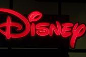 Disney sign glows at Walt Disney World's Epcot Center November 11 2001 in Orlando Florida