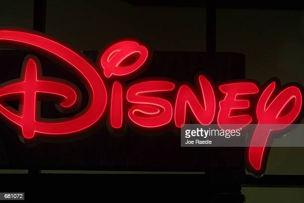 Disney sign glows at Walt Disney World's Epcot Center November 11 2001 in Orlando Florida