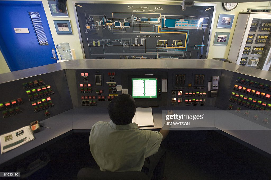 A Disney Work employee monitors a pump station for the water used in the Living Seas attration at Disney World's Epcot in Orlando Florida April 10...