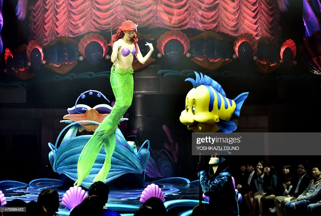 Disney's Little Mermaid character Ariel sings and displays wireaction performance in the air during the press preview of the new attraction 'King...