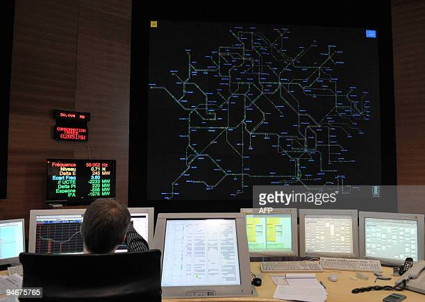 A dispatcher checks the map screen at the French electricity transport network operator RTE national dispatching room on December 17 2009 in...