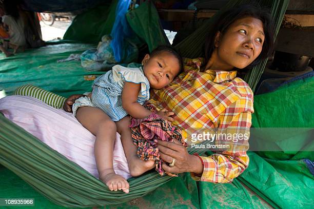 A displaced Cambodian mother fleeing the flighting at Preah Vihear temple holds her baby at a makeshift refugee camp February 9 2011 in the rural...
