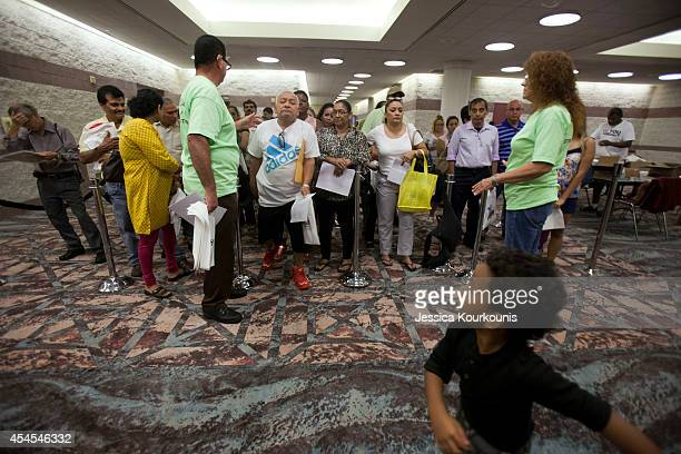 Displaced casino workers line up to file for unemployment with help from officials from the State Department of Labor and the main casino workers'...