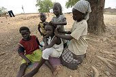 Displaced children plait a fellow's hair at StTheresa's IDP Camp in Yola Adamawa State in northern Nigeria on June 19 2015 The European Commission...