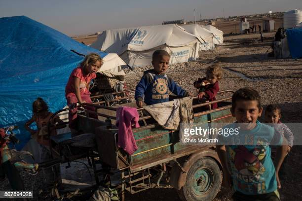 Displaced children play on a cart at a camp for internally displaced people on October 29 2017 in Ain Issa Syria Following three and a half months of...