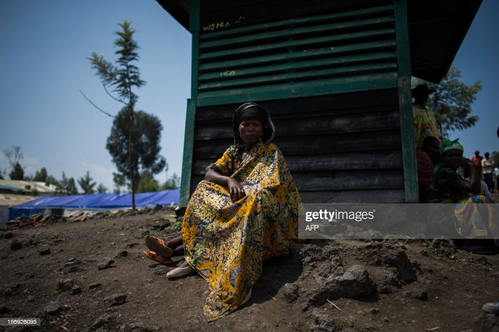 A displaced Congolese sits on the grounds of a religious organisation on the outskirts of Goma in the east of the Democratic Republic of the Congo on November 25, 2012. Over half a million people have been displaced in eastern Congo since the outbreak of the M23 rebellion. Diplomatic efforts continued on November 25 to resolve the crisis in eastern DR Congo, with an M23 rebel leader expected to hold further talks with President Joseph Kabila as the African Union called on the rebels to pull out from Goma.