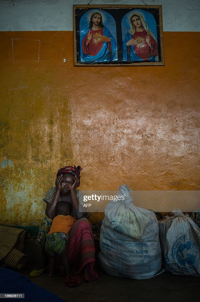 A displaced Congolese woman sits in the sports hall of a religious organization on the outskirts of Goma in the east of the Democratic Republic of the Congo on November 25, 2012. Over half a million people have been displaced in eastern Congo since the outbreak of the M23 rebellion. Diplomatic efforts continued on November 25 to resolve the crisis in eastern DR Congo, with an M23 rebel leader expected to hold further talks with President Joseph Kabila as the African Union called on the rebels to pull out from Goma.