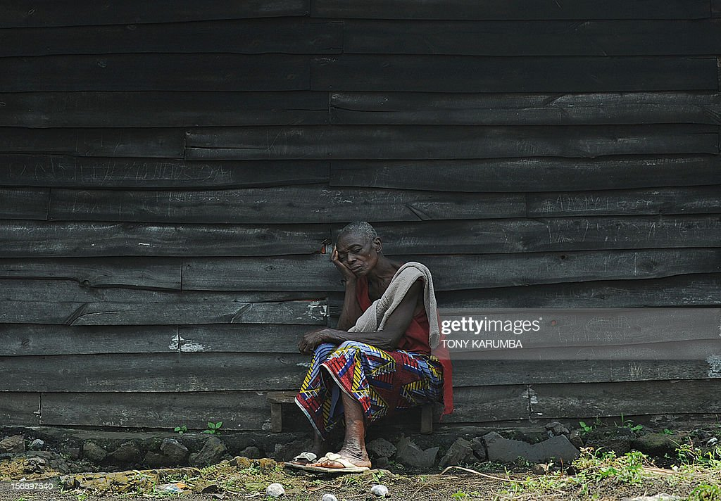 A displaced Congolese woman sleeps as she leans against a wooden structure, on November 24, 2012 during a food distribution excercise conducted by humanitarian agencies at a camp for the internally displaced in Mugunga. Thousands of people have been displaced in sporadic fighting between M23 rebel outfit against government forces in easten D.R. Congo's north-Kivu region after M23 seized control of the regional capital Goma. Regional leaders called on DR Congo rebel group M23 Saturday to end hostilities and relinquish a key eastern town it seized in an advance that has sparked fears of a wider conflict. The meeting of heads of state went forward without a key player -- Rwandan President Paul Kagame, whose country the United Nations accuses of backing the rebels -- and wrapped up quickly. AFP PHOTO/Tony KARUMBA