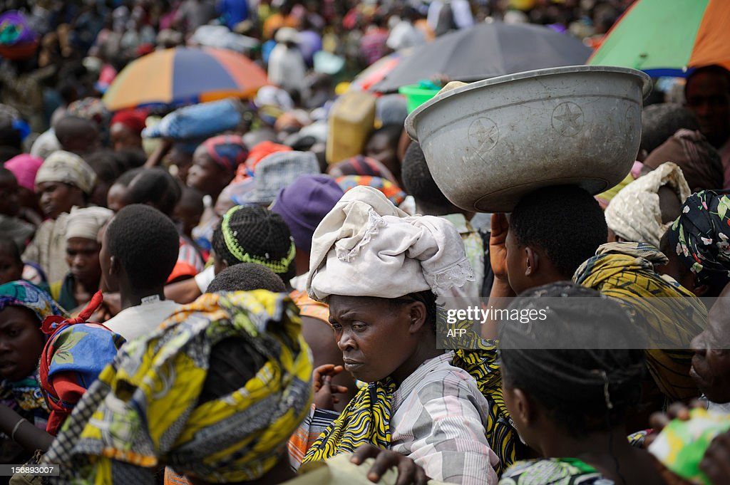 A displaced Congolese woman stands in a crowd of people waiting for humanitarian aid in a camp for the internally displaced in Mugunga, 8km west of Goma in the east of the Democratic Republic of the Congo on November 24, 2012. Tens of thousands of people are displaced in Mugunga alone following fighting between the government army and M23 rebels, who took Goma on Tuesday.