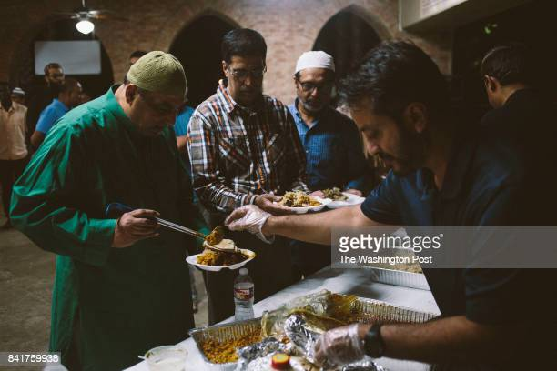 Displaced families gather for dinner at the ISGH Brand Lane Islamic Center in Stafford Texas on Thursday August 31 2017 John Taggart for The...