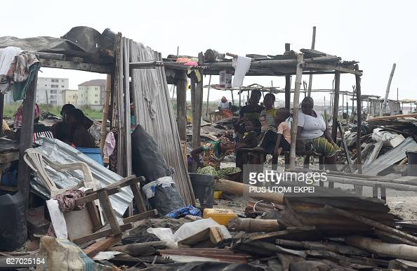 A displaced family sits on makeshift structures after their home was demolished by the authorities at Otodo Gbame waterfront fishing communities in...