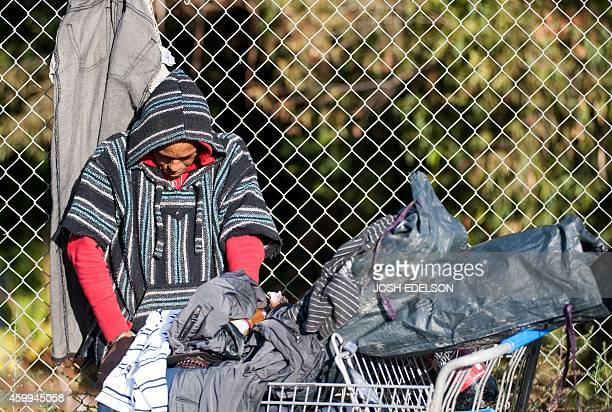 A displaced homeless person reacts as bulldozers move on a Silicon Valley homeless encampment known as The Jungle on December 4 in San Jose...