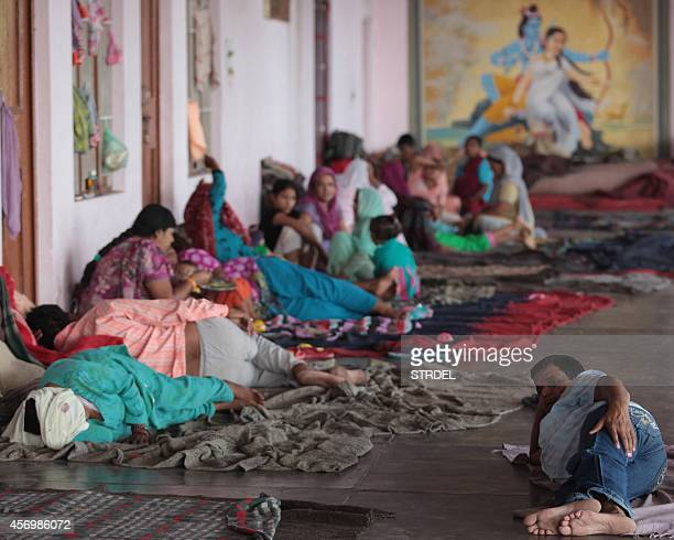 Displaced Indian villagers who fled their homes following crossborder firing along the IndiaPakistan border rest at the Chichi Mata Temple in Samba...