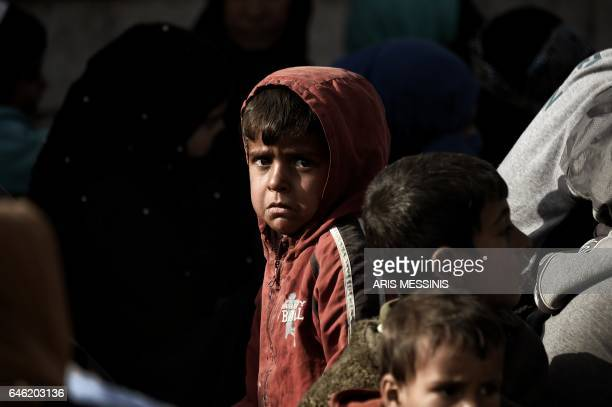TOPSHOT A displaced Iraqi boy cries as he flees the city of Mosul while Iraqi forces battle against Islamic State group jihadists to recapture the...