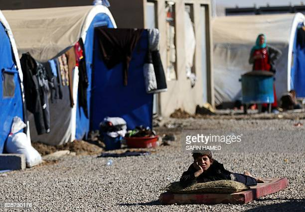 A displaced Iraqi boy who fled the violence in the northern city of Mosul as a result of a planned operation to retake the Iraqi city from jihadists...