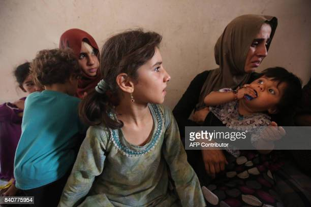 A displaced Iraqi child from Tal Afar lies at a house in AlAyadieh village on August 29 where he got injured as his family was seeking shelter during...
