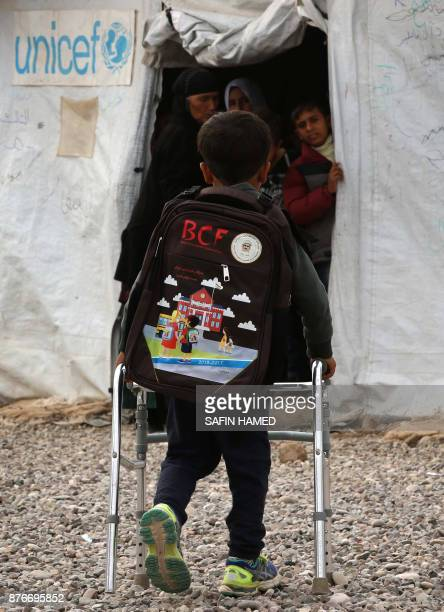 A displaced Iraqi child uses a walking aid as he heads to a United Nations Childrens Fund school at the Hasan Sham camp some 40 kilometres east of...