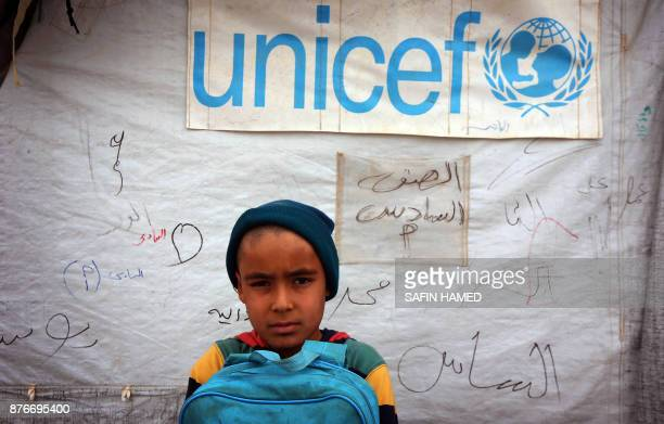 Displaced Iraqi children from the former embattled city of Mosul are seen at a United Nations Childrens Fund school at the Hasan Sham camp some 40...