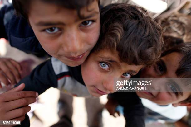 TOPSHOT Displaced Iraqi children who fled the violence in the northern city of Mosul as a result of a planned operation to retake the city from...
