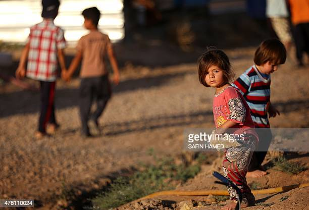 Displaced Iraqi children who fled their homes due to attacks by the Islamic State group are seen at the Harsham refugee camp where they found shelter...
