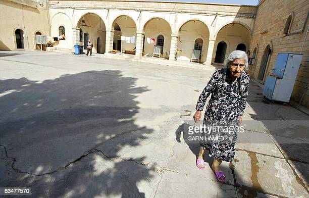 A displaced Iraqi Christian woman walks in the courtyard of AlSayida monastery in AlQush village 45 kms north of Mosul on October 14 2008 where he...