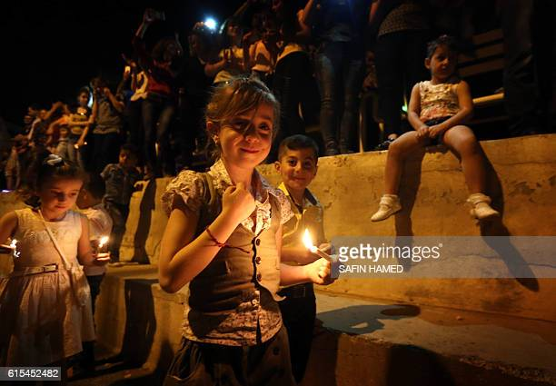 TOPSHOT Displaced Iraqi Christians take part in celebrations on October 18 2016 in Arbil the capital of the autonomous Kurdish region of northern...