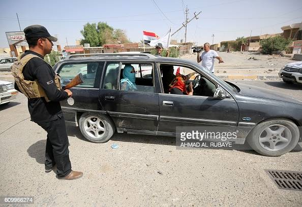 A displaced Iraqi family returns to the town of Sharqat around 80 kilometres south of the city of Mosul on September 23 the day after Iraqi...
