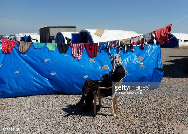 TOPSHOT A displaced Iraqi man who fled the violence in the northern city of Mosul as a result of a planned operation to retake the city from...