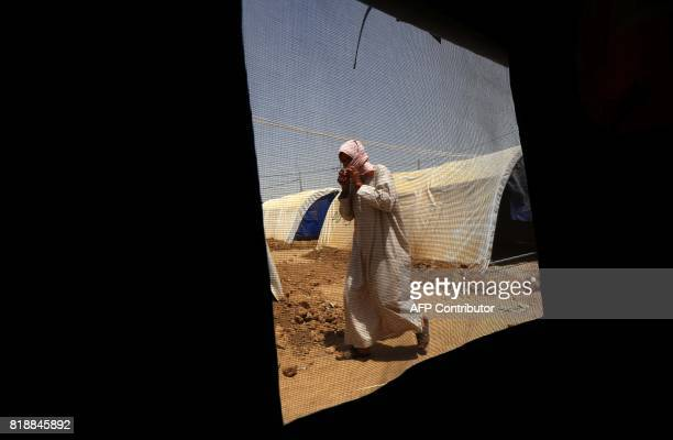 Displaced Iraqi man who had fled the violence around the northern Iraqi city of Mosul as a result of a planned operation to retake the Iraqi city...