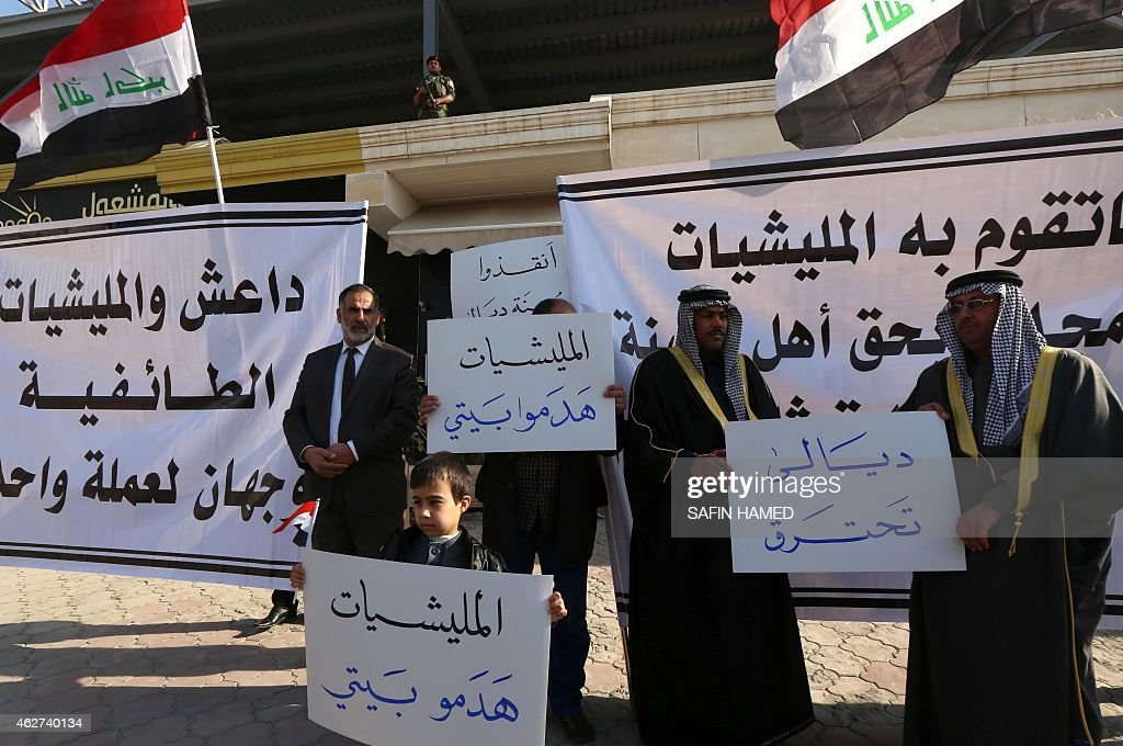 Displaced Iraqi Sunni Muslims who fled militants from the Islamic State group after they took over their hometowns in the Diyala province demonstrate...