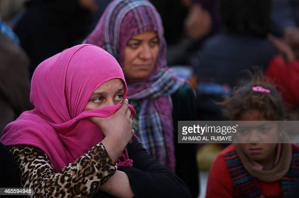 A displaced Iraqi Sunni woman who fled with many others the villages of of Albu Ajil and AlDor due to fighting between Islamic State group militants...