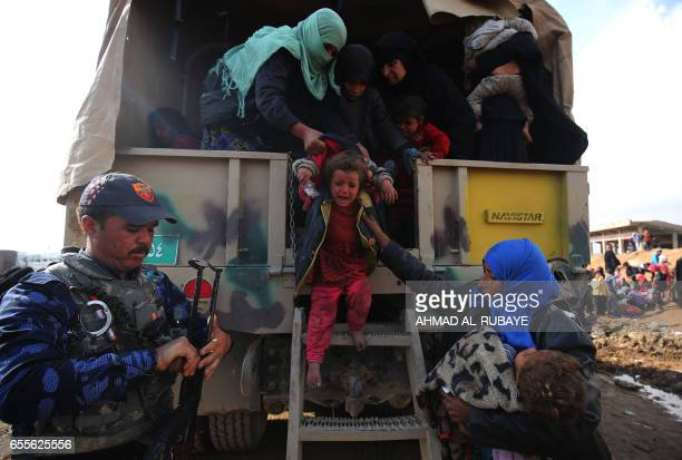 TOPSHOT Displaced Iraqis from Mosul arrive at the Hamam alAlil camp on March 20 during the government forces ongoing offensive to retake the western...