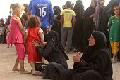 Displaced Iraqis from the embattled city of Fallujah wait for water supply at a camp where they are taking shelter some 30 kilometres on the southern...