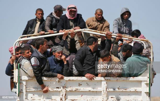TOPSHOT Displaced Iraqis who fled their homes in the Old City in western Mosul due to the ongoing fighting between government forces and Islamic...
