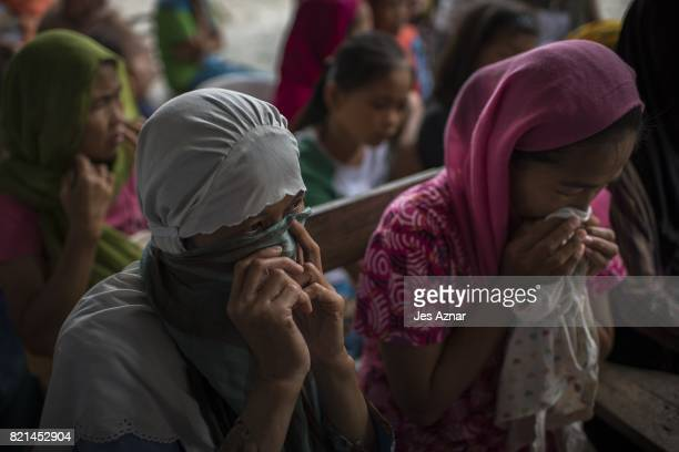 Displaced Marawi residents shed tears as they hear a collleague lament their condition outside their traditional villages and under martial rule on...