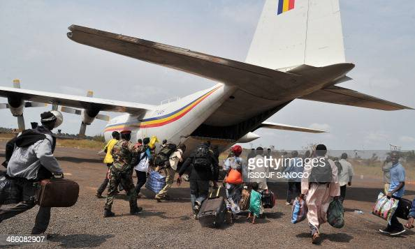 Displaced Muslims from Central Africa Chad and other countries fleeing attacks by Christian extremist militias rush to board a plane bound for...