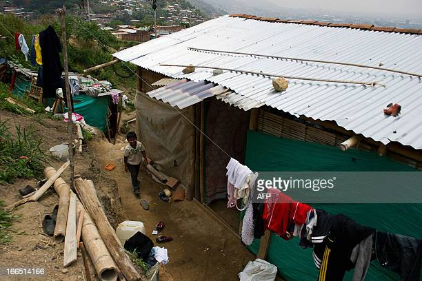 A displaced Nasa indigenous child is seen in a settlement in a mountainous area in Cali Valle del Cauca department Colombia on April 13 2013 The ONIC...