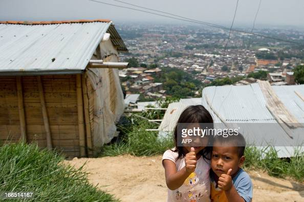 Displaced Nasa indigenous children gesture in a settlement in a mountainous area in Cali Valle del Cauca department Colombia on April 13 2013 The...