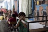 A displaced Palestinian child takes shelter at the Abu Hussien UN school in the Jabalia refugee camp in the northern Gaza Strip after the area was...