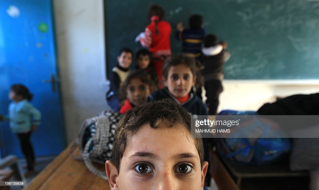 Displaced Palestinian children from the al-Attar family, who fled their house, play in a classroom, their temporary residence, at a United Nations-run school in Gaza City, on November 20, 2012. Israeli leaders discussed an Egyptian plan for a truce with Gaza's ruling Hamas, reports said, before a mission by the UN chief to Jerusalem and as the toll from Israeli raids on Gaza rose over 100.