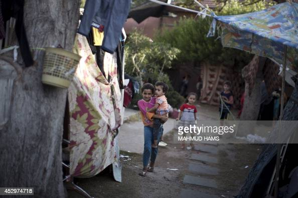 Displaced Palestinian children gather at the alShifa hospital in Gaza City where they have taken refuge after fleeing attacks in the Shejaiya...